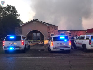 Louisiana State Fire Marshall vehicles are seen outside the Greater Union Baptist Church during a fire, in Opelousas, Louisiana, April 2, 2019 in this picture obtained from social media. Photo courtesy Louisiana Office Of State Fire Marshal/Handout via Reuters