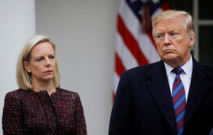 U.S. President Donald Trump speaks to reporters as Department of Homeland Security Secretary Kirstjen Nielsen looks on in the Rose Garden after the president met with U.S. Congressional leaders about the government shutdown and border security at the White House in Washington, U.S., January 4, 2019. Photo by Carlos Barria/Reuters