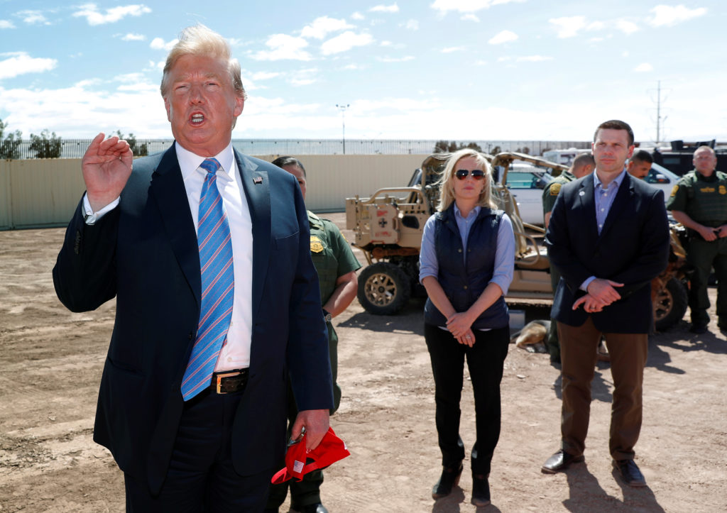 Homeland Security Secretary Kirstjen Nielsen and commissioner for Customs and Border Patrol Kevin McAleenan listen to U.S. President Donald Trump speak during a visit to a section of border wall in Calexico California, on April 5, 2019. During his visit, Trump said the U.S. could not take any more migrants becaue the country was