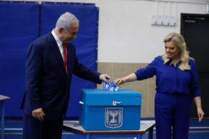 Israel's Prime Minister Benjamin Netanyahu casts his vote with his wife Sara during Israel's parliamentary election in Jerusalem, April 9, 2019. Photo by Ariel Schalit/Pool via Reuters