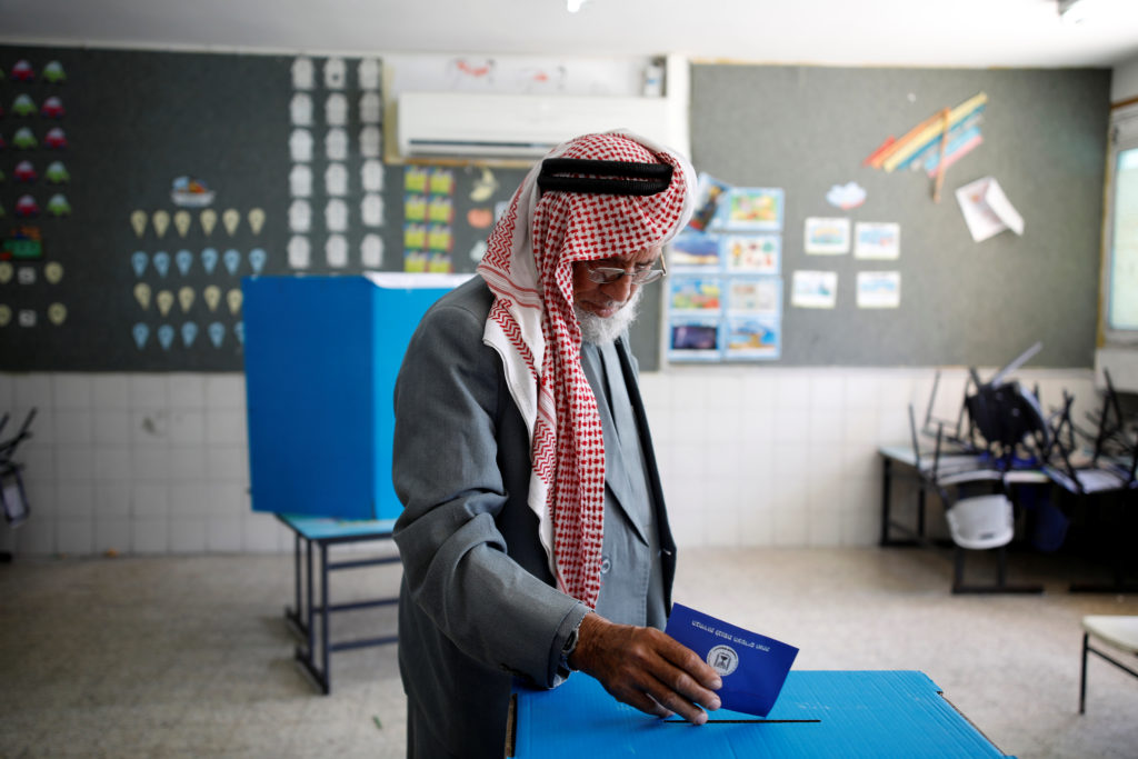 A Bedouin man casts his ballot as Israelis vote in a parliamentary …