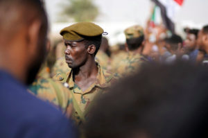 A Sudanese soldier stands guard as demonstrators attend a protest rally demanding Sudanese President Omar Al-Bashir to step down outside the Defence Ministry in Khartoum, Sudan on April 11, 2019. Photo by Reuters