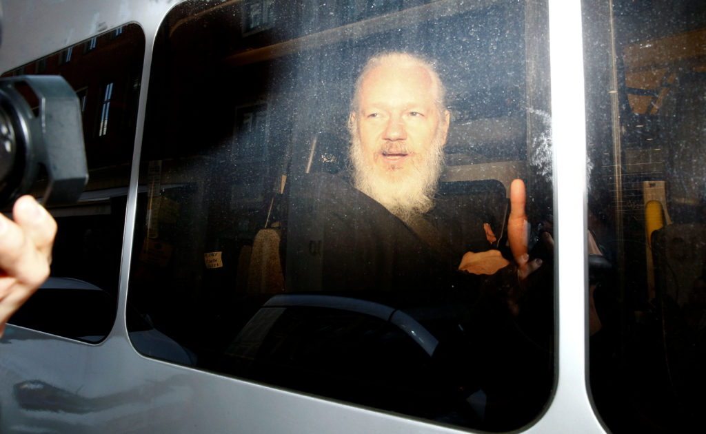 WikiLeaks founder Julian Assange is seen in a police van, after he was arrested by British police, in London, Britain. Photo by Henry Nicholls/Reuters