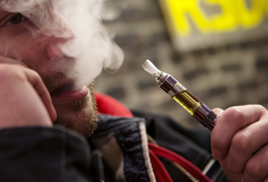 A man puffs on an e-cigarette in New York City. The Food and Drug A…