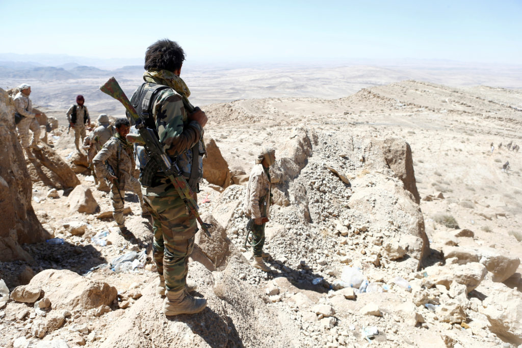 Yemeni soldiers stand on their position on a mountain on the frontl…