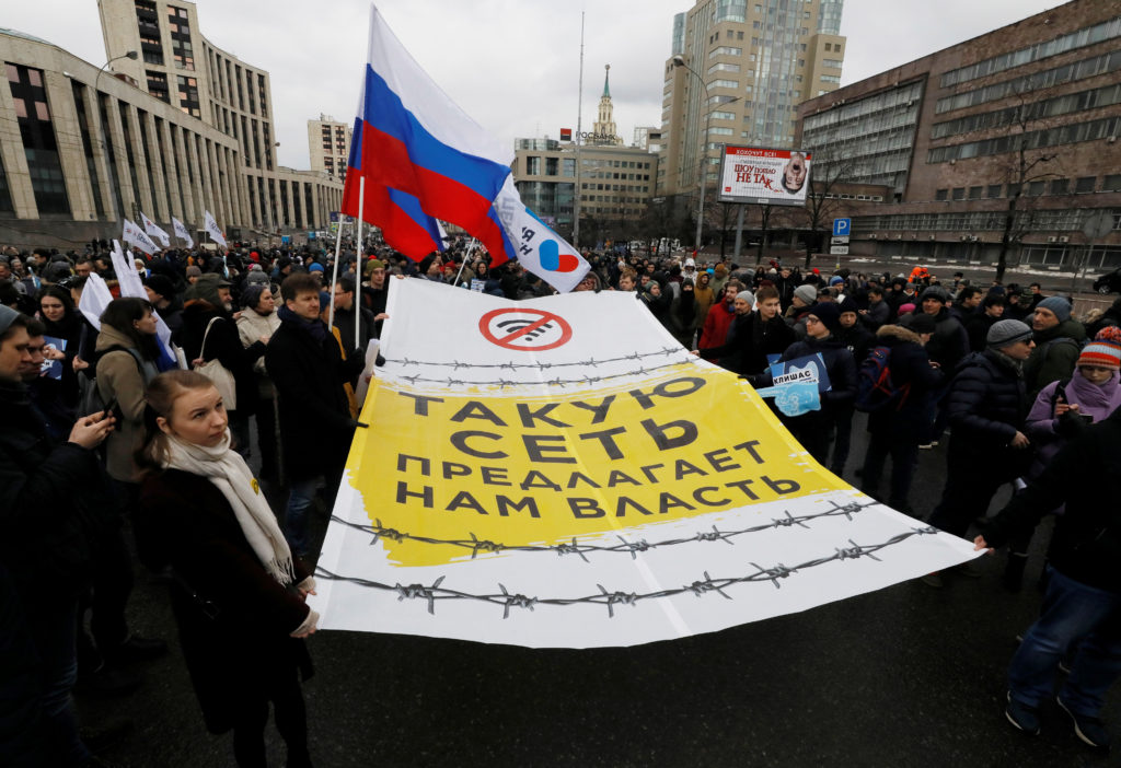 People attend a rally to protest against tightening state control over internet in Moscow, Russia, March 10, 2019. The ban...