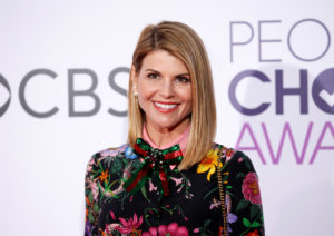 FILE PHOTO: Actress Lori Loughlin arrives at the People's Choice Awards 2017 in Los Angeles, California. Loughlin is set to appear in court Wednesday where she will face charges for her role in a college admissions scam. Photo by Danny Moloshok/Reuters