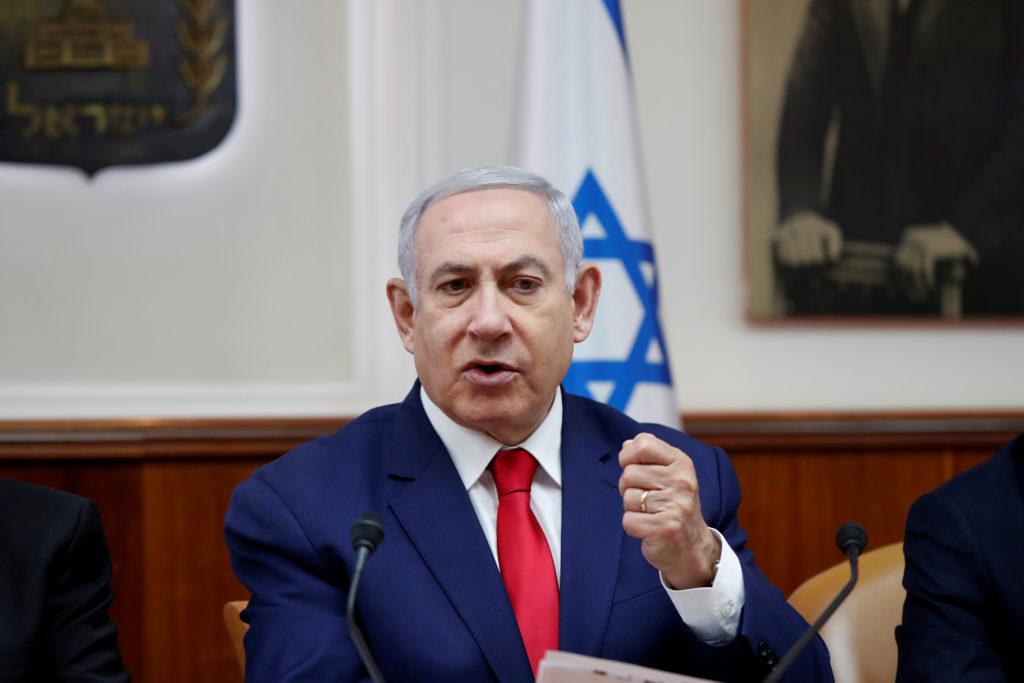 FILE PHOTO: Israeli Prime Minister Benjamin Netanyahu gestures during a weekly cabinet meeting in Jerusalem, April 14, 201...