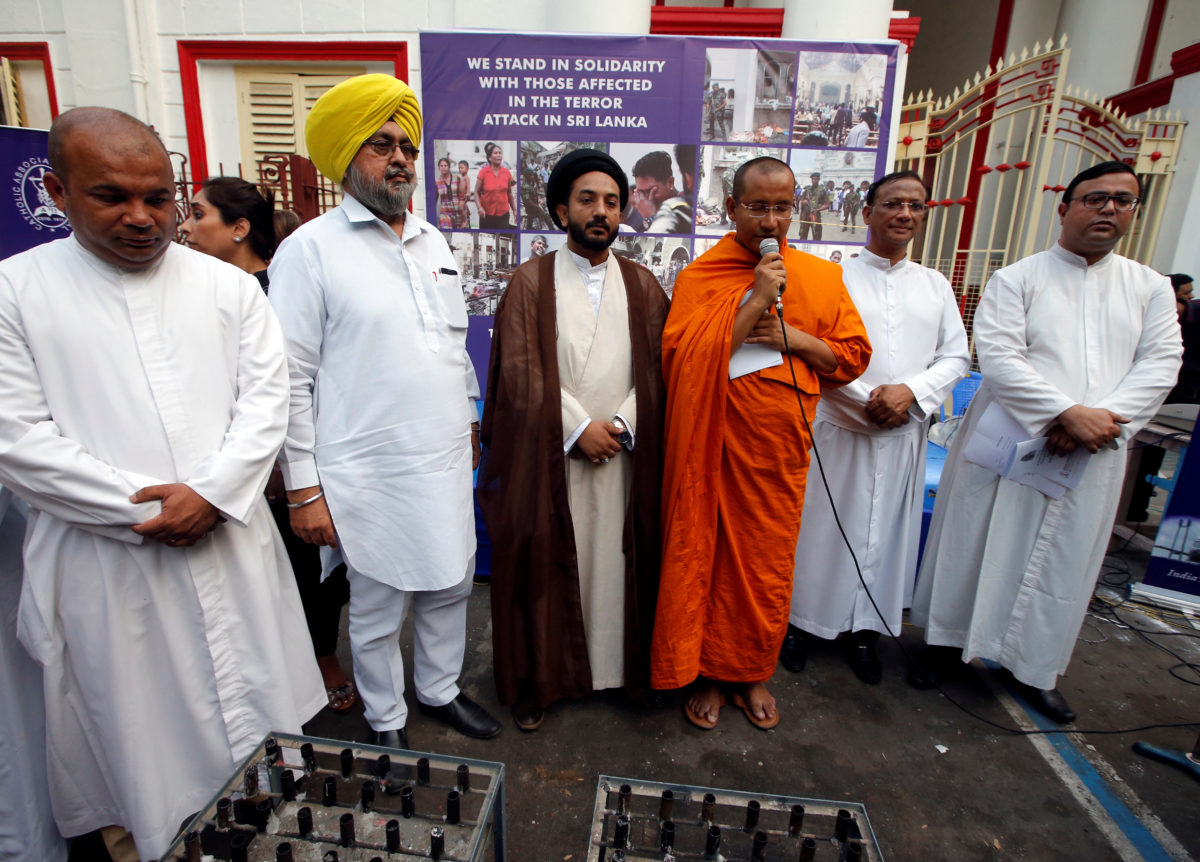 Multi-faith priests attend at a prayer meeting to show solidarity with the victims of Sri Lanka's serial bomb blasts, outside a church in Kolkata, India, April 23, 2019. Photo by Rupak De Chowdhuri/Reuters