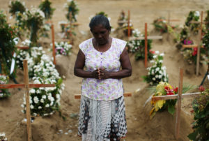A woman reacts during mass burials near St. Sebastian church in Negombo, Sri Lanka April 28, 2019. Photo by Athit Perawongmetha/Reuters