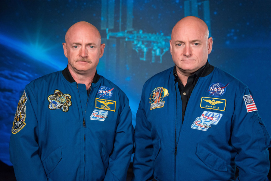 Mark Kelly (left) and Scott Kelly are identical twins. Scott Kelly spent a year in space, while his brother stayed on Earth. Researchers compared the genetic, physical and cognitive changes in the twins to find out how long-term space travel affects humans. Photo by NASA/Robert Markowitz