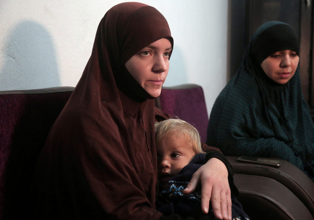 FILE PHOTO: Belgian women Tatiana Wielandt and Bouchra Abouallal, both 26, who joined Islamic State in Syria are pictured in Ain Issa, Syria March 10, 2019. While some countries have repatriated former members of ISIS on an ad hoc basis in the past, the fall of the caliphate has forced the U.S. and its allies to seek a more permanent fix. REUTERS/Issam Abdallah/File Photo.