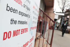 A sign warning people of measles in the ultra-Orthodox Jewish community of Williamsburg, two days after New York City Mayor Bill de Blasio declared a public health emergency in parts of Brooklyn in response to a measles outbreak, is seen in New York, U.S., April 11, 2019. Photo by REUTERS/Shannon Stapleton