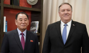 U.S. Secretary of State Mike Pompeo poses with Vice Chairman of the North Korean Workers' Party Committee Kim Yong Chol, North Korea's lead negotiator in nuclear diplomacy with the United States, as they start talks aimed at clearing the way for a second U.S.-North Korea summit while meeting at a hotel in Washington, U.S., January 18, 2019. Photo by REUTERS/Joshua Roberts