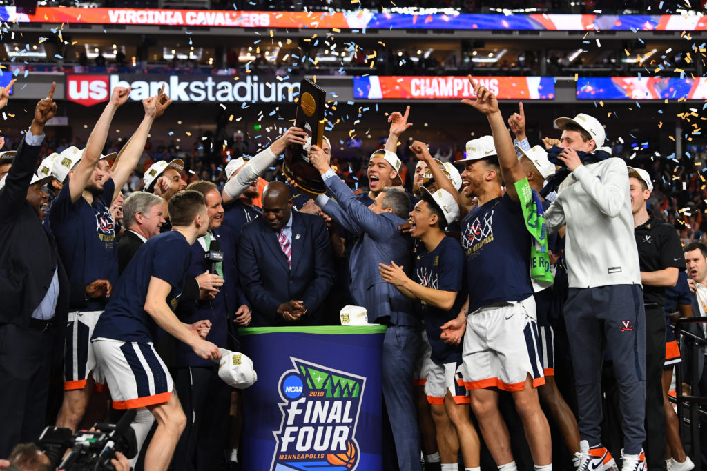 Apr 8, 2019; Minneapolis, MN, USA; Virginia Cavaliers hoist the championship trophy after defeating the Texas Tech Red Raiders in the championship game of the 2019 men's Final Four at US Bank Stadium. Mandatory Credit: Robert Deutsch-USA TODAY Sports