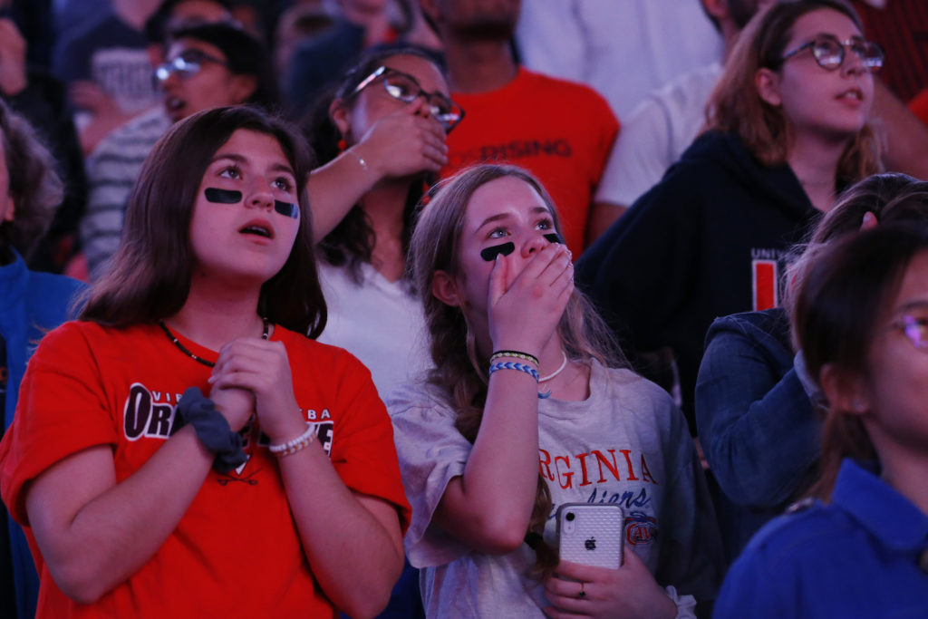 Apr 8, 2019; Charlottesville, VA, USA; Virginia Cavaliers fans react during a viewing party at John Paul Jones Arena for the the championship game of the 2019 men's Final Four between the Texas Tech Red Raiders and the Cavaliers. Mandatory Credit: Geoff Burke-USA TODAY Sports