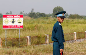 A Vietnamese soldier stands guard at the dioxin contaminated area while U.S. Secretary of Defense Jim Mattis (not pictured) visits Bien Hoa airbase on October 17, 2018, where the U.S. army stored the defoliant Agent Orange during the Vietnam War, in Bien Hoa city, outside Ho Chi Minh City, Vietnam. Photo by REUTERS/Kham/Pool