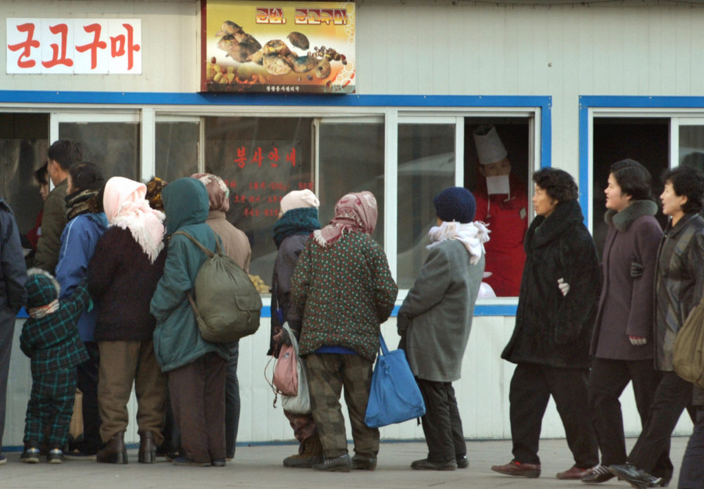 People line up in front of a food store in Pyongyang November 26, 2010. Photo by Kyodo via Reuters