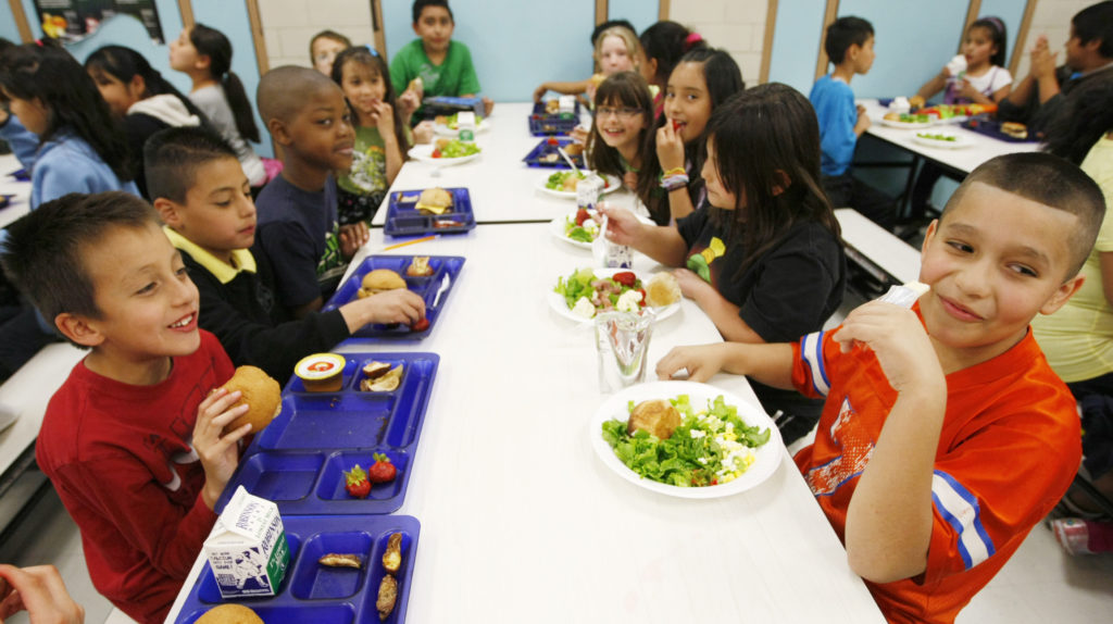 Students at Rose Hill Elementary School enjoy their lunch in Commerce City, Colorado on May 1, 2012. Photo by Rick Wilking/Reuters