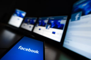 The loading screen of the Facebook application on a mobile phone is seen in this photo illustration. Photo by Valentin Flauraud/Reuters