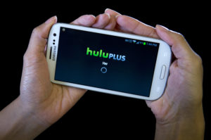 The HULU Plus app is played on a Samsung Galaxy phone in this photo-illustration. Photo by Carlo Allegri/Reuters