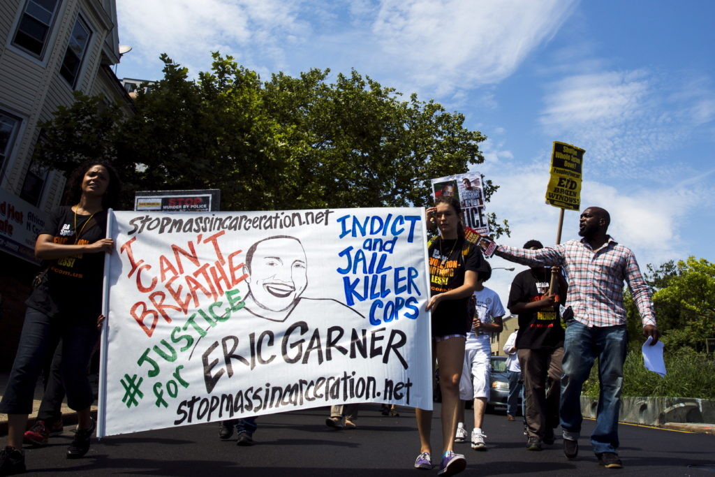 Demonstrators protest as they march to the location where Eric Garner was killed on the one year anniversary of his death in New York, July 17, 2015. Family and supporters on Friday marked the anniversary of the police killing of Eric Garner with rallies and vigils demanding police reforms and justice in the controversial case. Photo by Lucas Jackson/Reuters