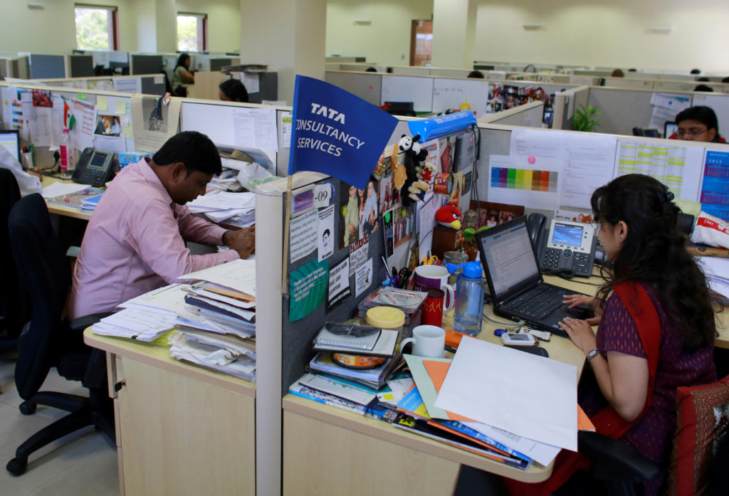 Employees of Tata Consultancy Services (TCS) work inside the company headquarters in Mumbai March 14, 2013.  the Trump administration has cracked down on services firms like TCS that sponsor a large number of H-1B visas. Photo by Danish Siddiqui/Reuters
