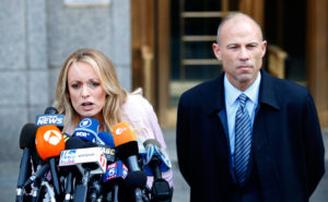 Adult film actress Stephanie Clifford, also known as Stormy Daniels, speaks to media along with lawyer Michael Avenatti (right) outside federal court in the Manhattan borough of New York City, New York, on April 16, 2018. Photo by Brendan Mcdermid/Reuters