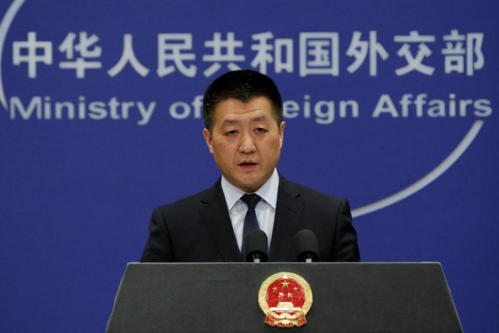 China keeps the door open to trade talks, but slams tech controls