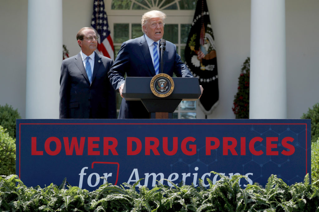 President Donald Trump and Secretary of Health and Human Services Alex Azar deliver remarks about prescription drug prices at the White House on May 11, 2018. Photo by Jonathan Ernst/Reuters
