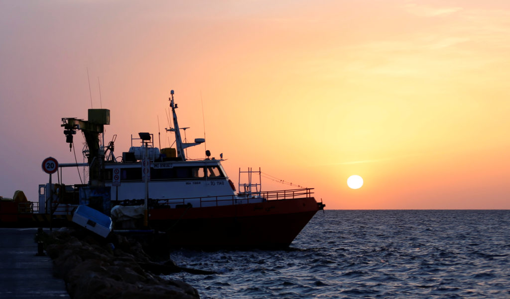 A boat is seen at a harbour off the cost of Tunisia. Picture taken June 4, 2018. Photo by Zoubeir Souissi/Reuters