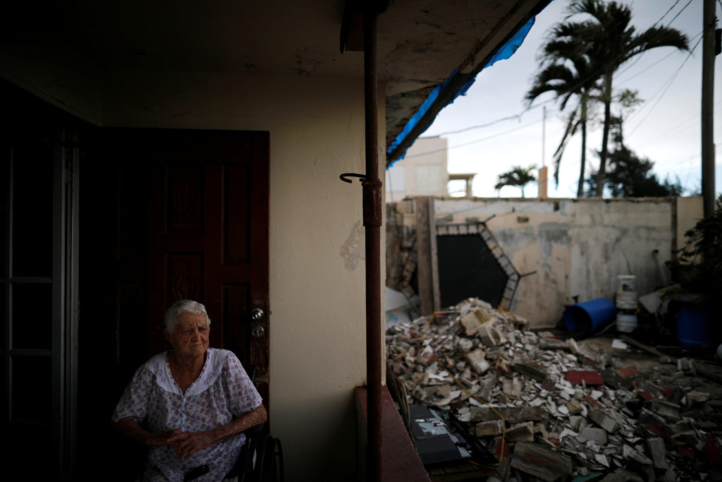 Lucila Cabrera, 86, sits at the porch of her damaged house by Hurricane Maria, a year after the storm devastated Puerto Rico, near Barceloneta, Puerto Rico. Picture taken September 18, 2018. Photo by Carlos Barria/Reuters
