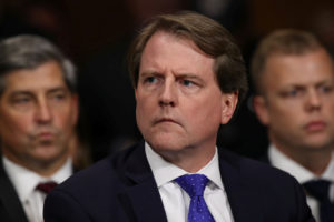 White House Counsel Don McGahn listens to Judge Brett Kavanaugh as he testifies before the Senate Judiciary Committee during his Supreme Court confirmation hearing in the Dirksen Senate Office Building on Capitol Hill in Washington, on September 27, 2018. Photo by Win McNamee/Pool via Reuters