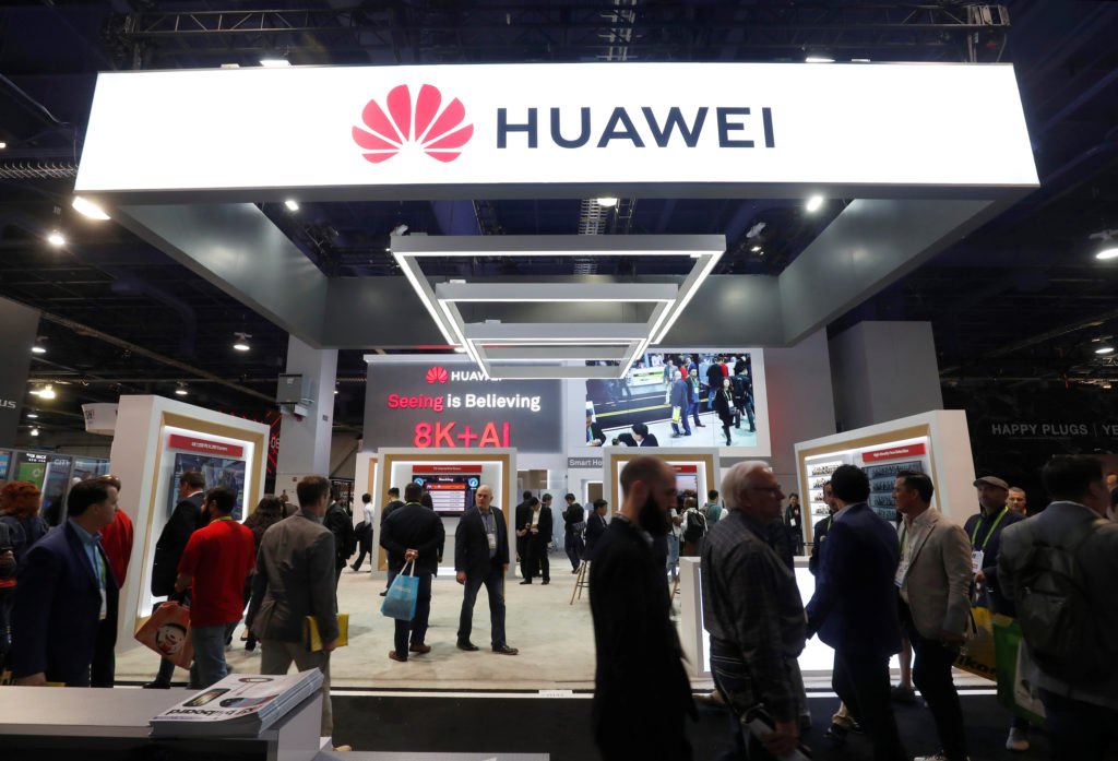 Attendees pass by a Huawei booth during the 2019 CES in Las Vegas, Nevada, on January 9, 2019. Photo by Steve Marcus/Reuters