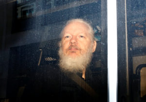 WikiLeaks founder Julian Assange is seen in a police van, after he was arrested by British police, in London on April 11, 2019. Photo by Henry Nicholls/Reuters