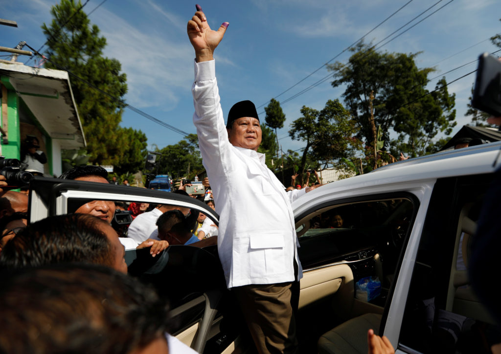 Indonesian presidential candidate Prabowo Subianto shows his ink-stained finger after voting at a polling booth during elections in Bogor, West Java, Indonesia April 17, 2019. Photo by Willy Kurniawan/Reuters