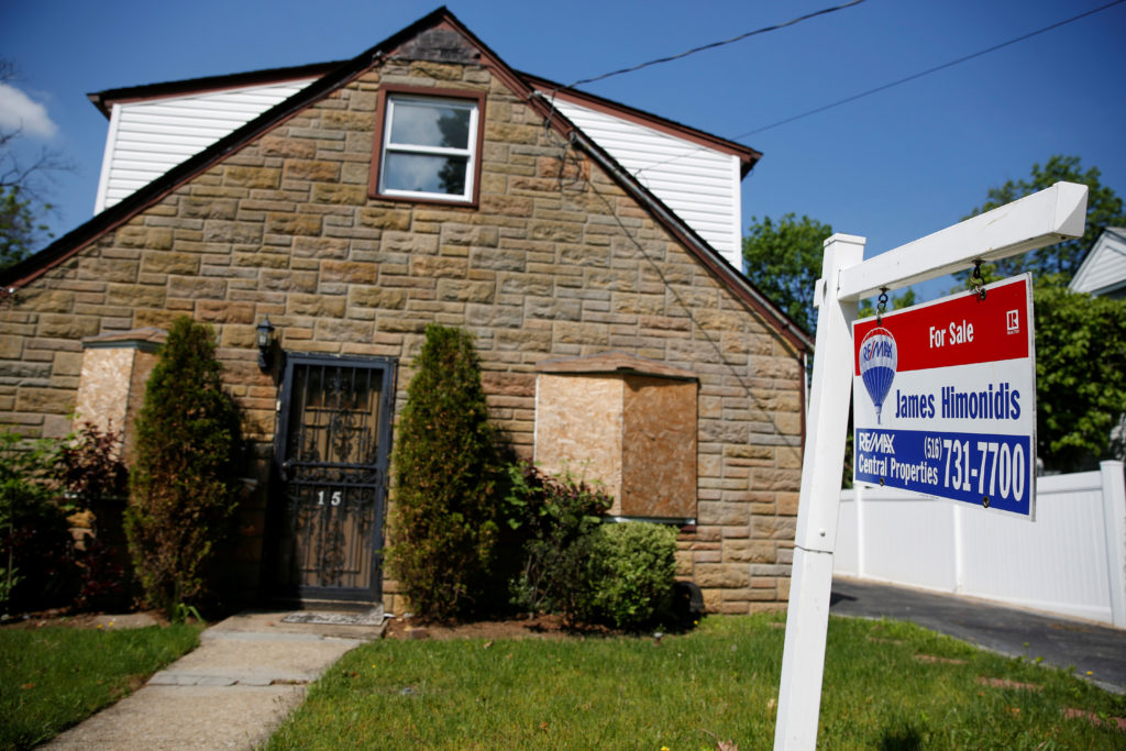 FILE PHOTO: A 'for sale' is seen outside a single family house in Garden City, New York, U.S. on May 23, 2016. Photo by Shannon Stapleton/Reuters