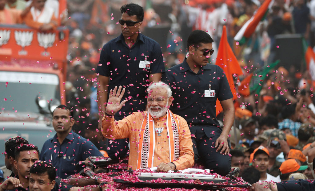 India's Prime Minister Narendra Modi waves towards his supporters during a roadshow in Varanasi, India, on April 25, 2019. Photo by Adnan Abidi/Reuters