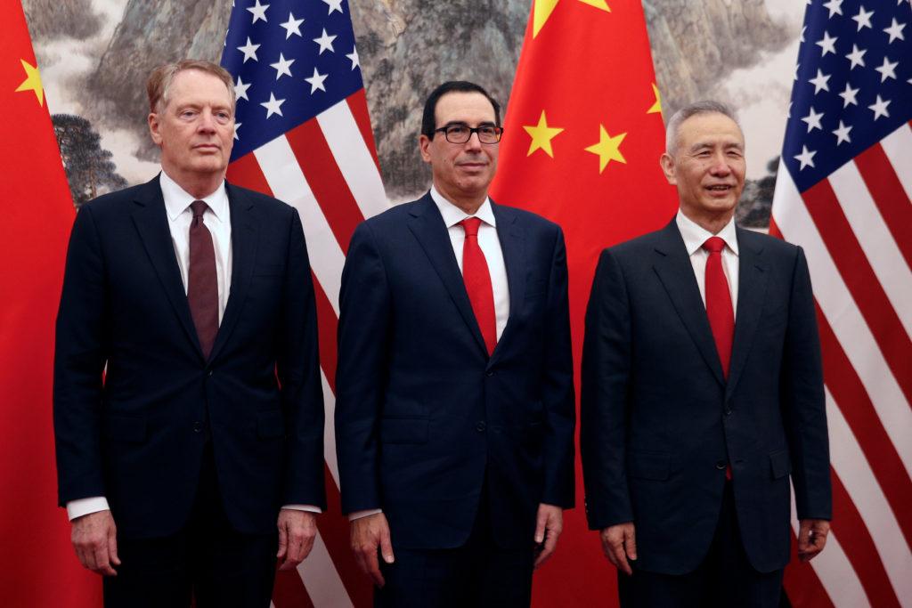 Chinese Vice Premier Liu He, right, poses with U.S. Treasury Secretary Steven Mnuchin, center, and U.S. Trade Representati...