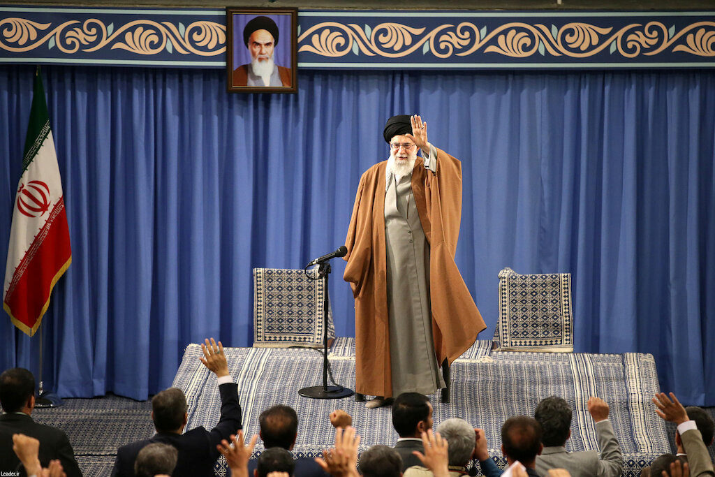 Iran's Supreme Leader Ayatollah Ali Khamenei waves as he delivers a speech during a meeting with teachers in Tehran, Iran,...