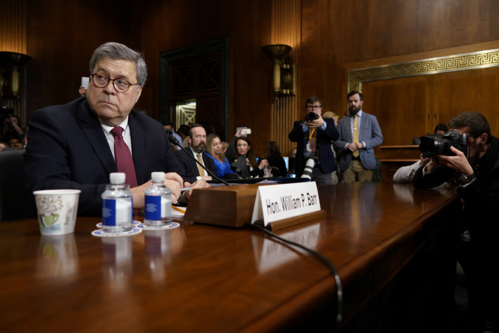 """Attorney General William Barr is seated prior to testifying before a Senate Judiciary Committee hearing on """"the Justice De..."""