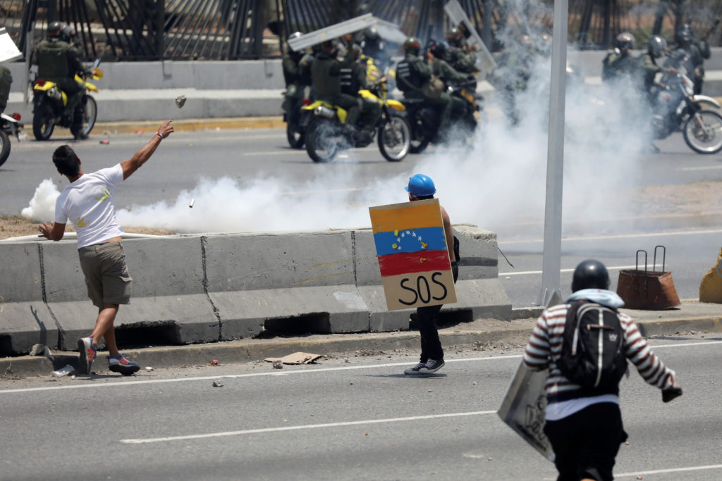 Supporters of Venezuelan opposition leader Juan Guaido, who many nations have recognised as the country's rightful interim...