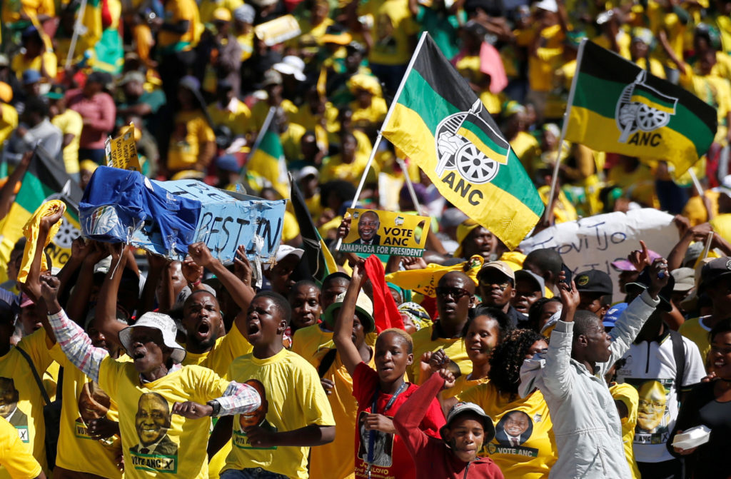 Supporters of South Africa's governing African National Congress carry a mock coffin of the opposition Democratic Alliance...