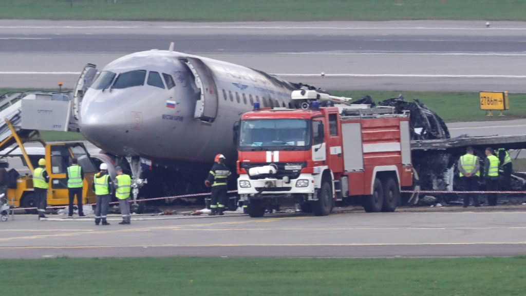 Members of emergency services and investigators work at the scene of an incident involving an Aeroflot Sukhoi Superjet 100...