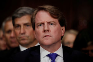 FILE PHOTO: White House Counsel Don McGahn listens to U.S. Supreme Court nominee Brett Kavanaugh testify before a Senate Judiciary Committee confirmation hearing on Capitol Hill in Washington, on September 27, 2018. Photo by Jim Bourg/Reuters