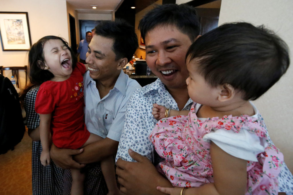 Reuters reporters Wa Lone and Kyaw Soe Oo celebrate with their children after being freed from prison, after receiving a presidential pardon in Yangon, Myanmar, on May 7, 2019. Photo by Ann Wang/Reuters