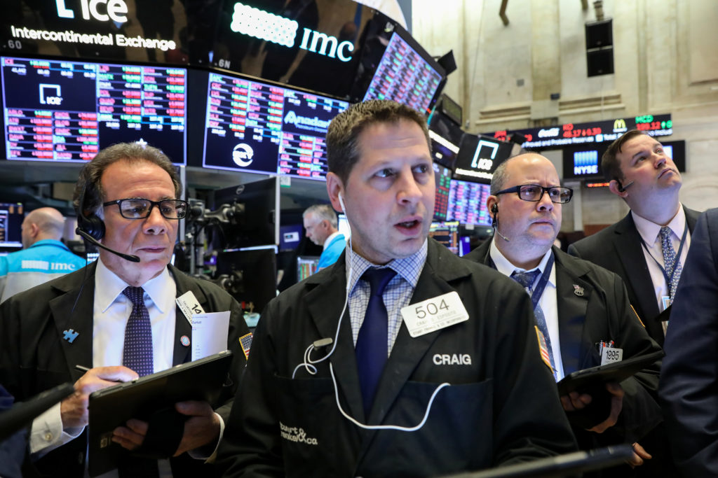 Traders work on the floor at the New York Stock Exchange in New Yor…