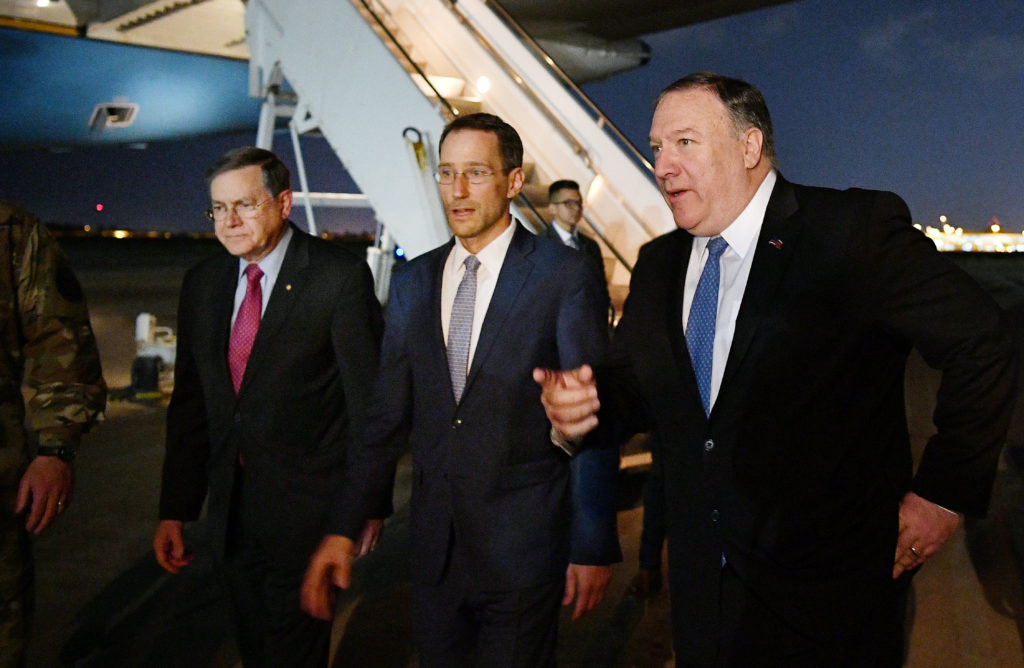 Secretary of State Mike Pompeo walks with Acting Assistant Secretary for Near Eastern Affairs at the State Department Davi...