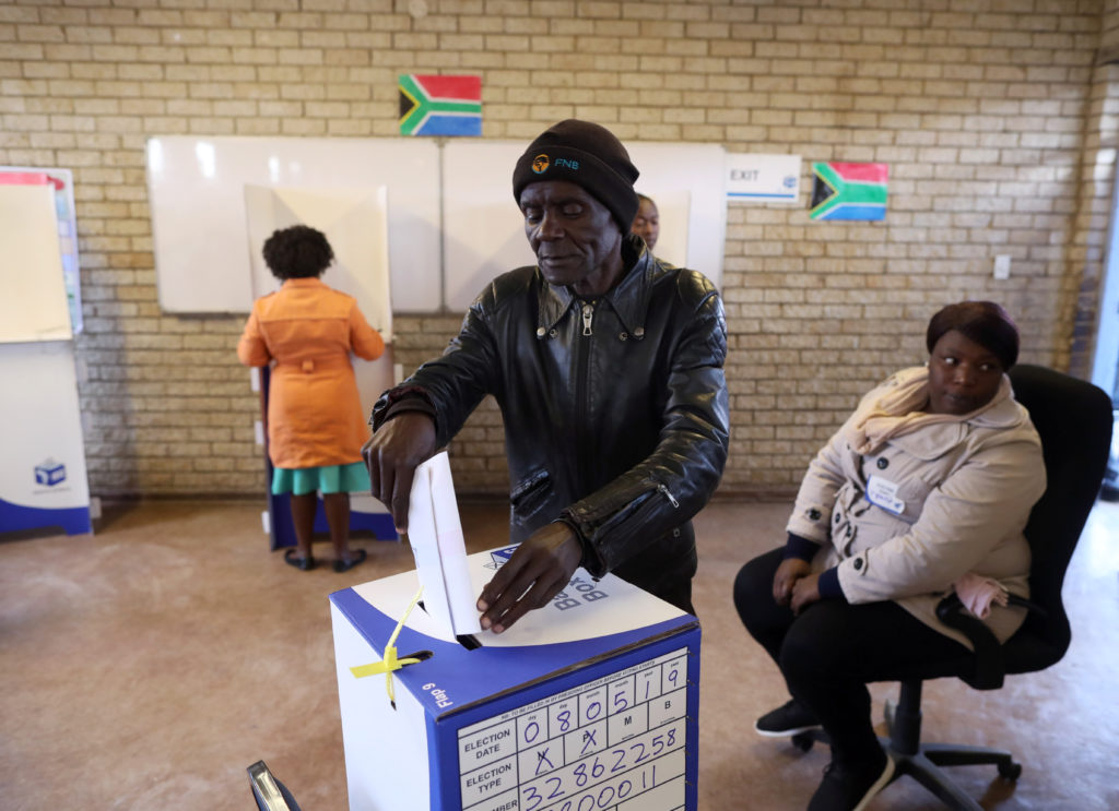 A voter casts his ballot at a polling station, during the South Africa's parliamentary and provincial elections in Soweto,...
