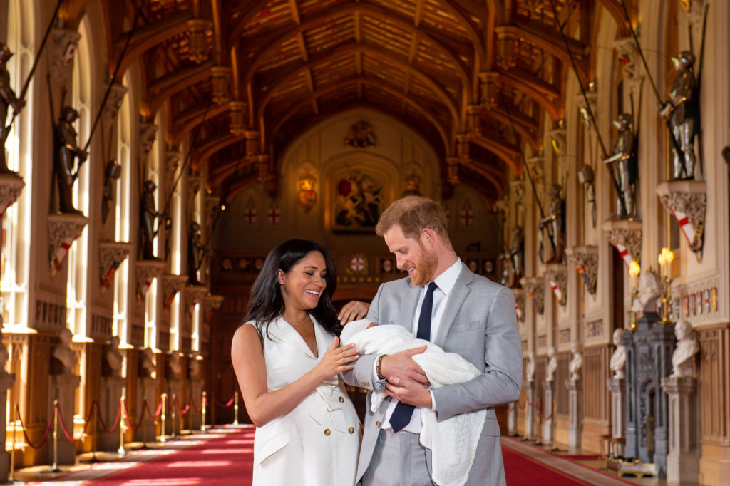 Britain's Prince Harry and Meghan, Duchess of Sussex are seen with their baby son, who was born on Monday morning, during a photocall in St George's Hall at Windsor Castle, in Berkshire, Britain May 8, 2019. Photo by Dominic Lipinski/Pool via Reuters